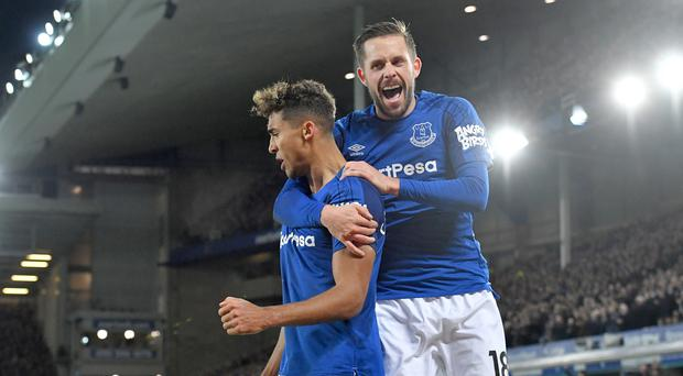 Dominic Calvert-Lewin, left, and Gylfi Sigurdsson, right, scored Everton's goals against Huddersfield