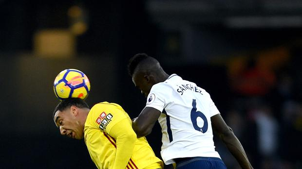 Troy Deeney, left, and Davinson Sanchez battled for the ball during the Premier League match which saw the Spurs defender dismissed