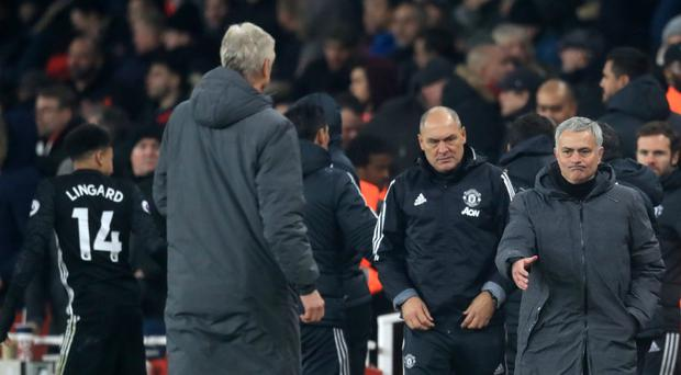 Jose Mourinho, right, and Arsene Wenger were critical of the officiating during Saturday's clash