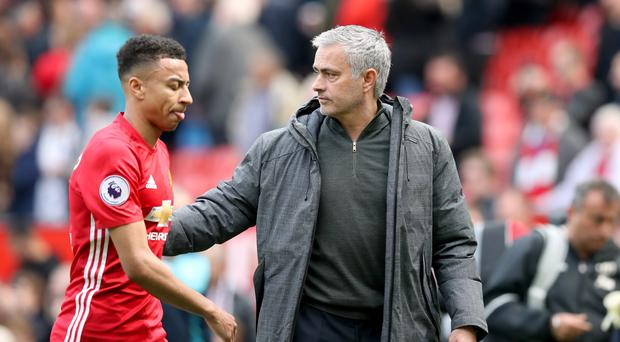 Jose Mourinho, right, praised Jesse Lingard following his two goals in Manchester United's win at Arsenal