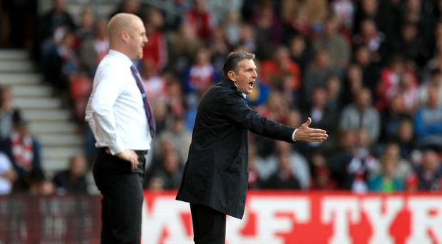 Leicester boss Claude Puel, right, and Burnley manager Sean Dyche on the touchline