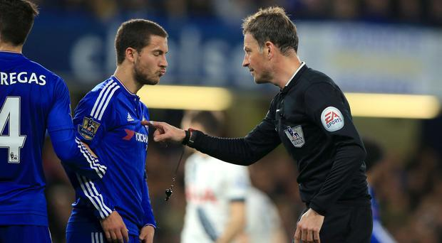 Referee Mark Clattenburg, right, speaks with Chelsea's Eden Hazard during the 2-2 draw with Tottenham