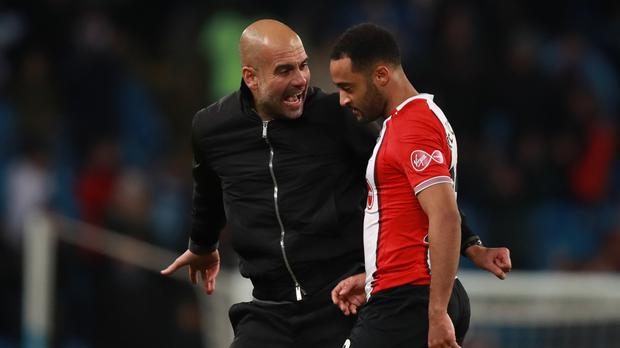 Pep Guardiola, left, exchanges words with Nathan Redmond after Manchester City's win over Southampton