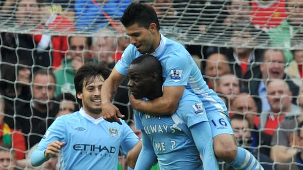 Mario Balotelli produced a t-shirt celebration after scoring in Manchester City's 6-1 derby win at Manchester United in October 2011