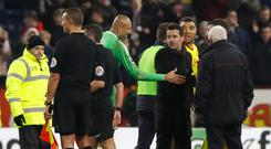 Watford manager Marco Silva speaks with referee Lee Probert