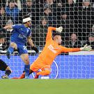 Ayoze Perez, left, scores an own goal to hand Leicester victory
