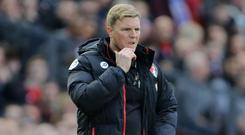 Bournemouth manager Eddie Howe has no intentions of any excessive celebrations should his side pull off a shock win at Manchester United
