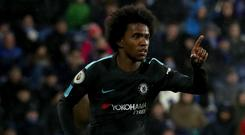 Chelsea forward Willian celebrates scoring against Huddersfield
