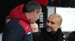 Pep Guardiola, right, saw Manchester City beat Paul Clement's Swansea to make history