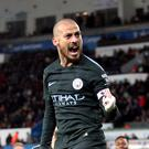 David Silva celebrates scoring his second goal in Manchester City's comfortable victory at Swansea.