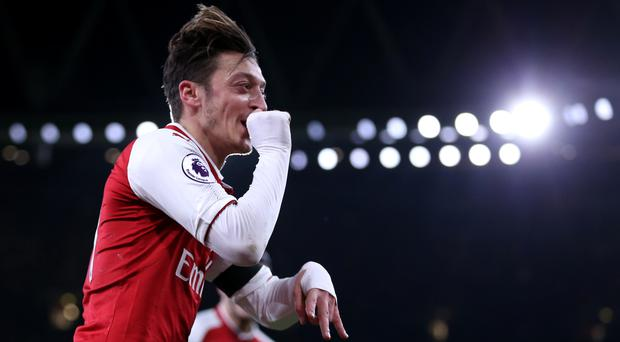 Arsenal's Mesut Ozil is reportedly keen to sign for Manchester United