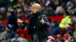 Pep Guardiola hailed his Manchester City record-breakers after their 4-0 win at Swansea