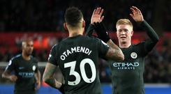 Kevin De Bruyne, right, is ever-present in Manchester City's winning run while Nicolas Otamendi has emerged as a goal threat