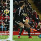 Dominic Solanke (right) beat West Brom's Ben Foster but was denied his first Liverpool goal after it was ruled out for handball.