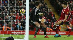 Dominic Solanke, right, beat West Brom's Ben Foster but was denied his first Liverpool goal after it was ruled out for handball