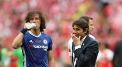 Chelsea head coach Antonio Conte, right, is disappointed at those questioning whether he is telling the truth over defender David Luiz's knee injury