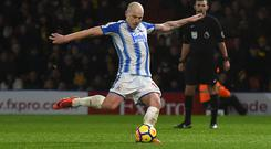 Aaron Mooy scored his second and Huddersfield's fourth from the penalty spot
