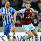 Glenn Murray, left, who missed a first-half penalty, challenged Charlie Taylor