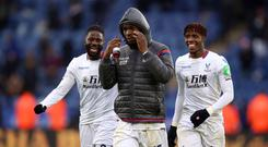 Crystal Palace's scorers Bakary Sako, Christian Benteke and Wilfried Zaha celebrate the 3-0 win at Leicester