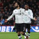 Mohamed Salah celebrates scoring Liverpool's third goal