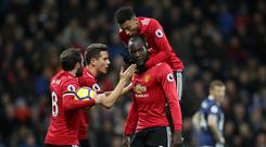 Manchester United's Romelu Lukaku is mobbed by his team mates after scoring in the 2-1 win at West Brom.