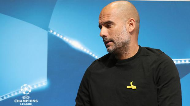 Manchester City manager Pep Guardiola has worn a yellow ribbon in support of imprisoned Catalan politicians