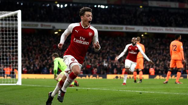 Alexis Sanchez, Granit Xhaka and Mesut Ozil, pictured, struck in quick succession before Liverpool rescued a point