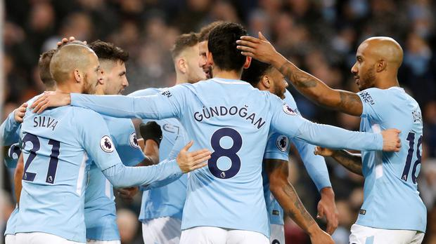 Manchester City's Sergio Aguero, second left, scored twice in Saturday's 4-0 win over Bournemouth which secured a 17th successive Premier League win