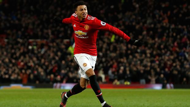 Jesse Lingard celebrates his late equaliser against Burnley