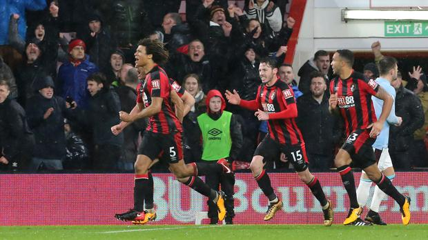 Bournemouth players celebrate their late equaliser against West Ham
