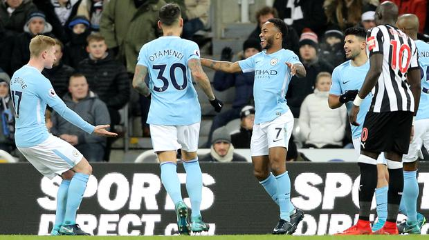 Manchester City number seven Raheem Sterling celebrates the winner at Newcastle