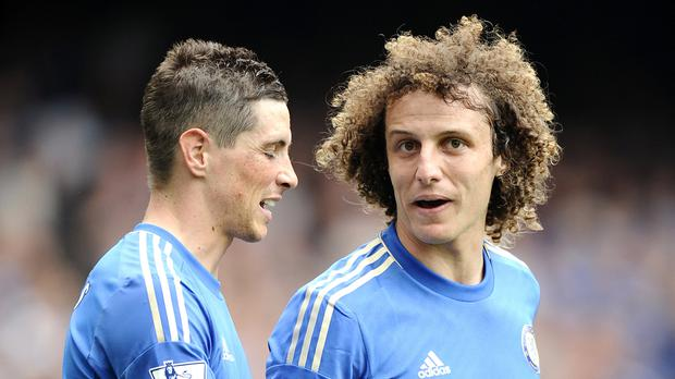 Chelsea spent big on Fernando Torres, left, and David Luiz in January 2011