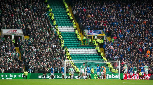 Police separate fans during the Old Firm Derby