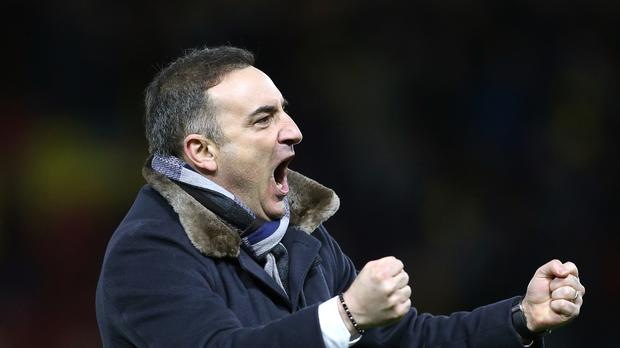 Carlos Carvalhal celebrates making a winning start to life as Swansea manager