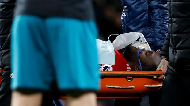Romelu Lukaku was carried off on a stretcher after receiving lengthy treatment on the pitch