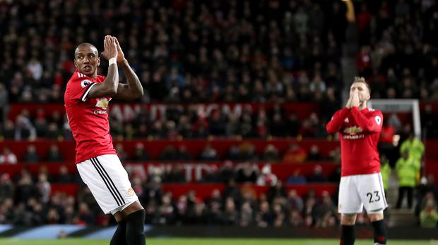Manchester United's Ashley Young, left, and Luke Shaw react to a missed shot at a goal during the draw with Southampton