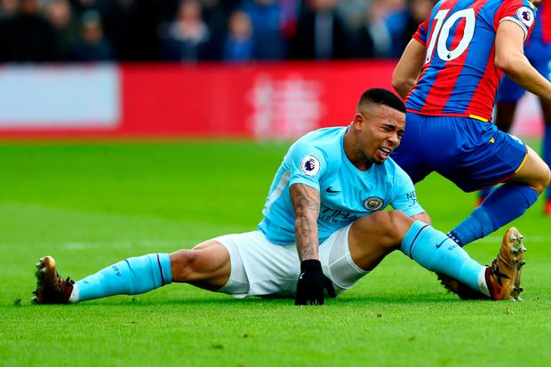 Manchester City's Gabriel Jesus reacts after injuring his knee during yesterday's clash with Crystal Palace Photo: Getty