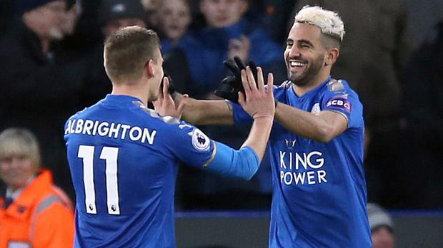 Riyad Mahrez, pictured right, opened the scoring for Leicester against Huddersfield