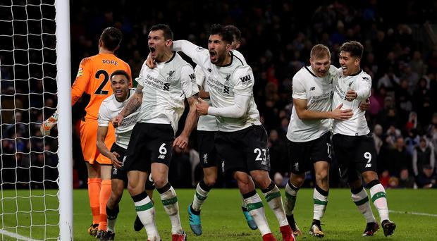 Liverpool's Ragnar Klavan (second right) celebrates scoring his side's second goal of the game with team-mate Liverpool's Roberto Firmino (right), Dejan Lovren (third left) and Emre Can (centre) during the Premier League match at Turf Moor, Burnley.