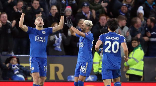 Leicester's Islam Slimani (left) celebrates his goal with fellow scorer Riyad Mahrez in the Foxes' 3-0 win over Huddersfield.