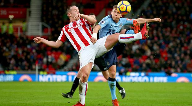 Stoke midfielder Charlie Adam, pictured, has called on the club to keep faith in manager Mark Hughes