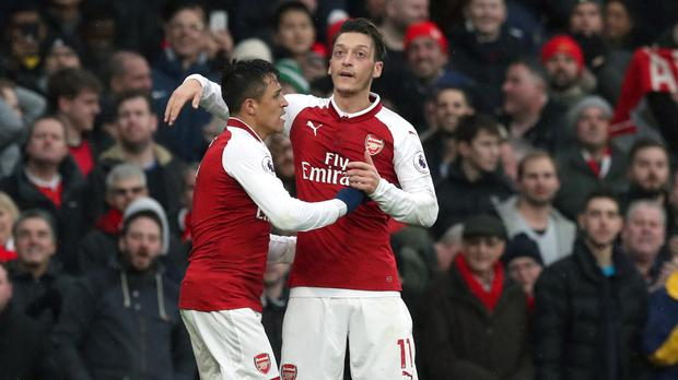 Alexis Sanchez (left) and Mesut Ozil are yet to extend their Arsenal contracts