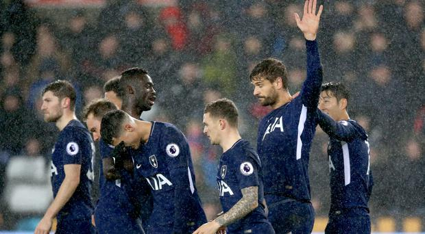 Tottenham's Fernando Llorente (second right) celebrates scoring his side's first goal of the game in their 2-0 win at Swansea.