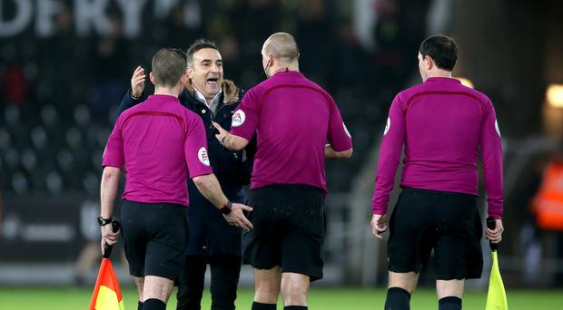 Swansea manager Carlos Carvalhal (second left) makes his point to referee Robert Madley (second right) after his side's controversial 2-0 defeat to Tottenham.