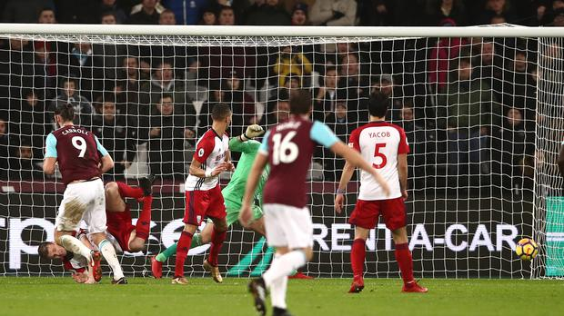 Andy Carroll, left, scored twice as West Ham beat West Brom