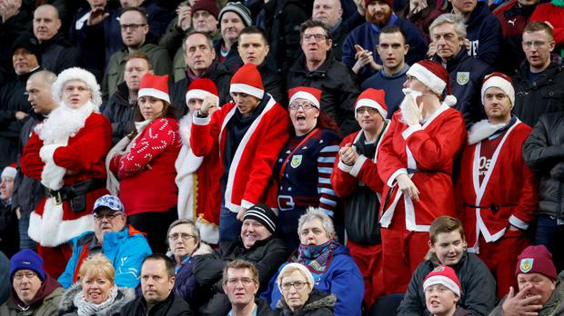 Football supporters watch a festive game in England