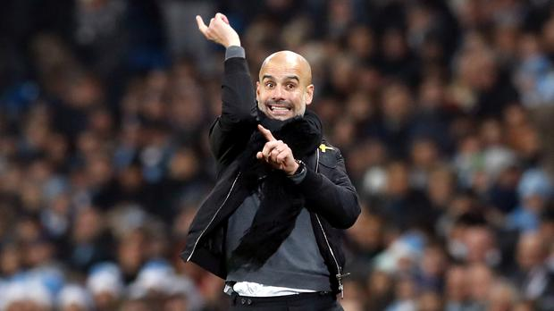 Pep Guardiola has dismissed talk of winning four trophies