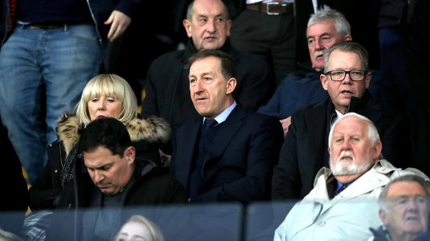 Huw Jenkins, centre, has faced calls to quit as Swansea chairman