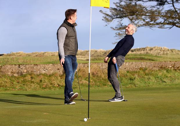 Stephen Hunt and Kevin Doyle pictured on the 18th green at Rosslare Golf Golf Club. Picture Credit:Frank Mc Grath