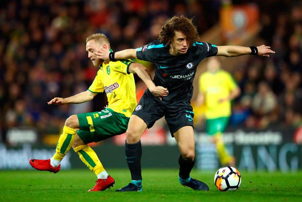 David Luiz of Chelsea is challenged by Alex Pritchard of Norwich City during The Emirates FA Cup Third Round match between Norwich City and Chelsea